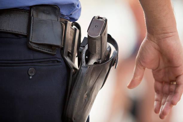 close-up of a police officer's service revolver - vakta bildbanksfoton och bilder