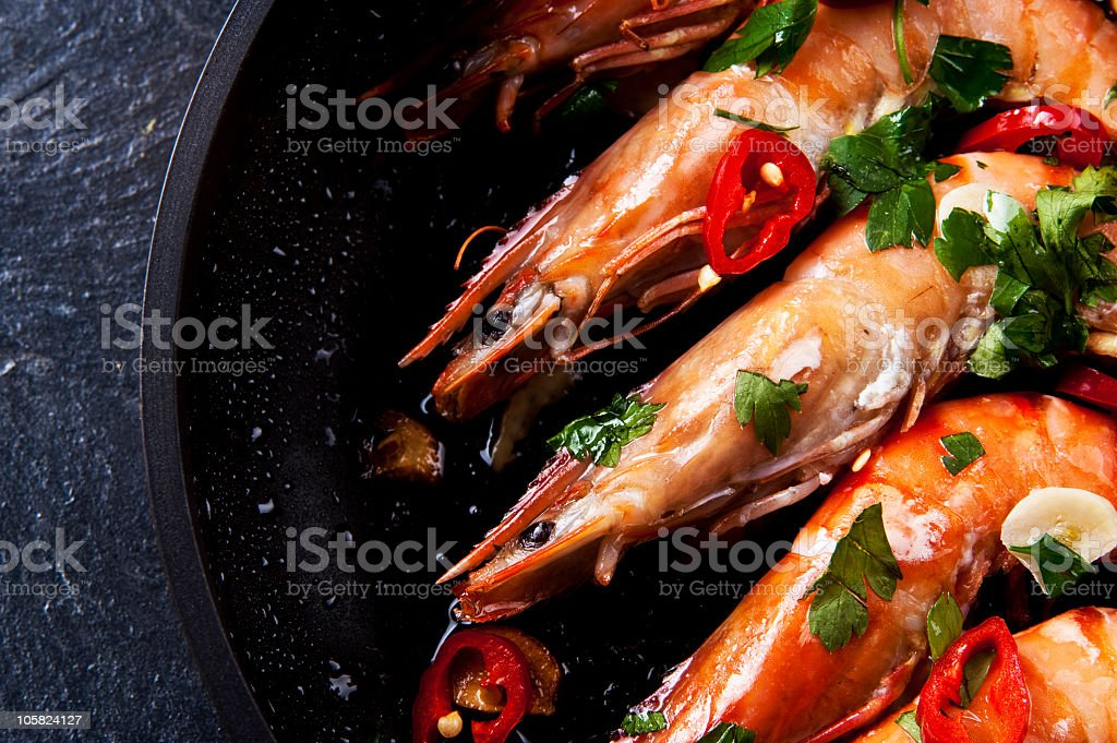 Close-up of a prawn chili dish with spices stock photo