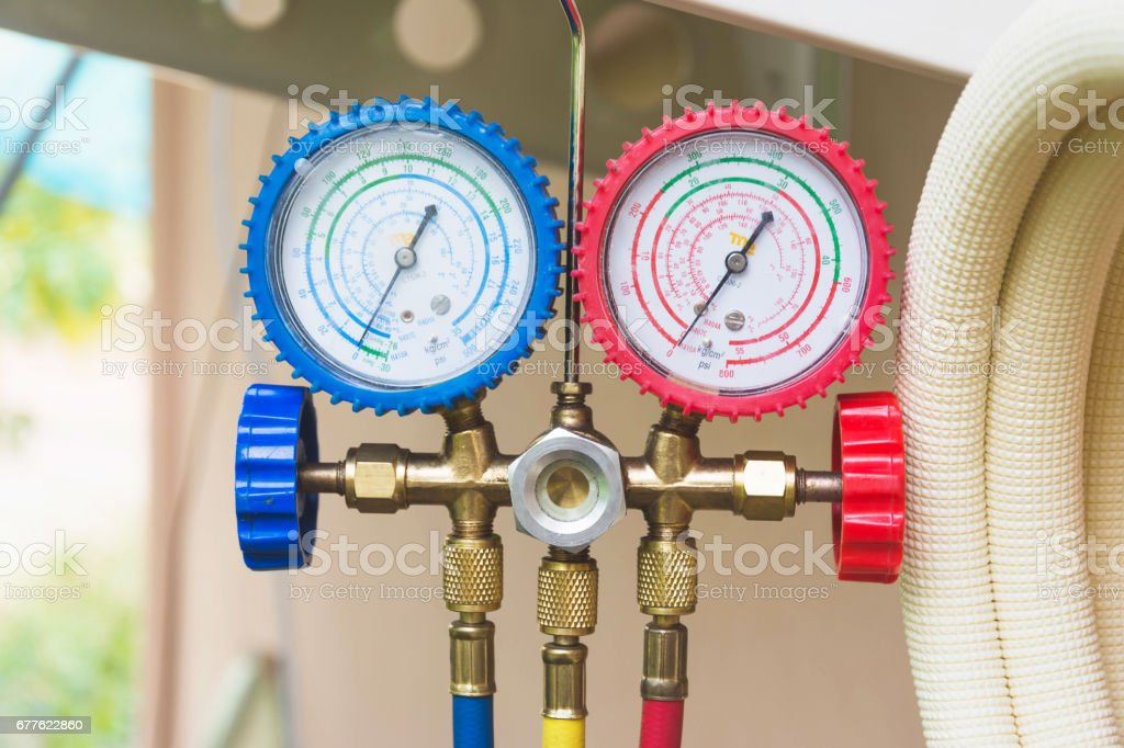 Closeup of a pressure meter on air conditioner stock photo