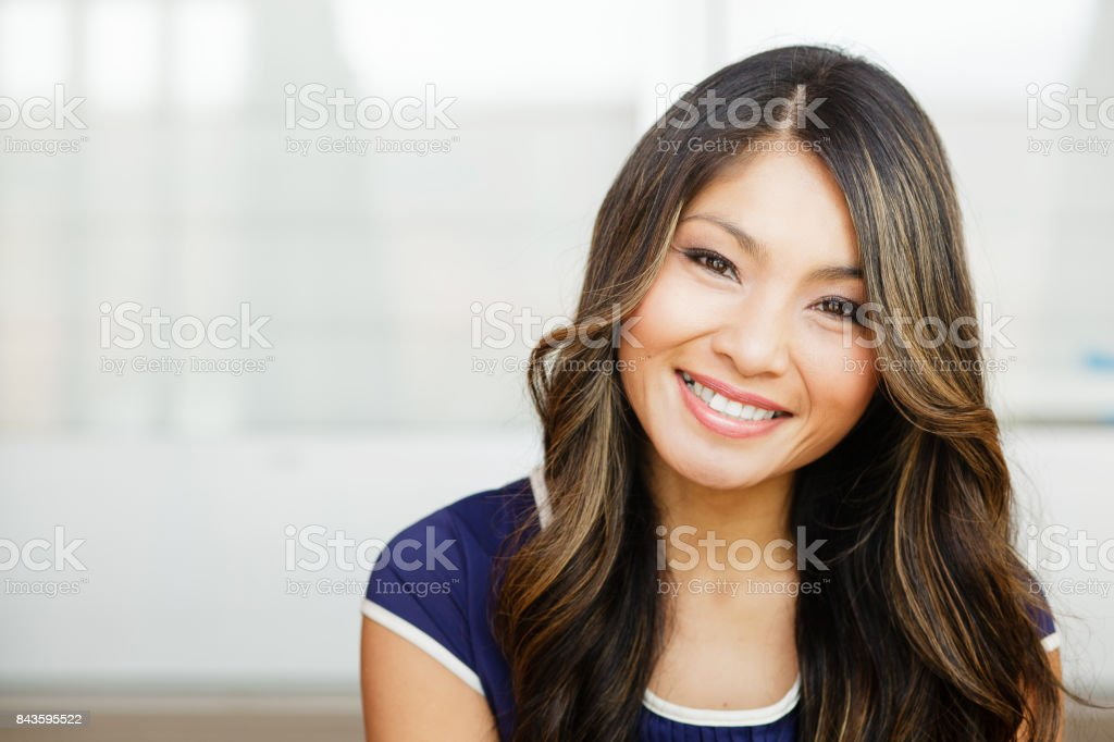 Close-up of a pretty Asian woman smiling in the city stock photo