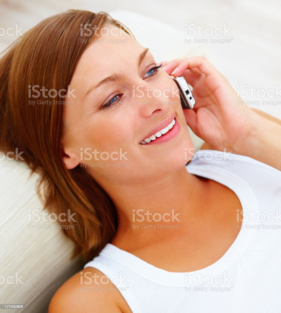 Closeup of a pretty woman talking on a cellphone stock photo