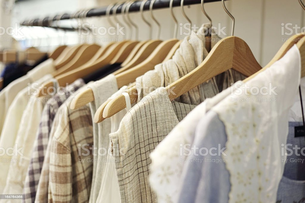 A close-up of a rack full of clothing stock photo