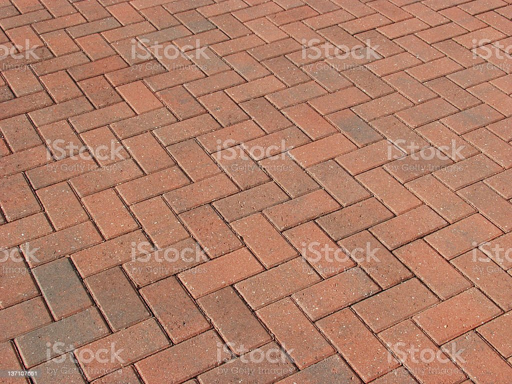 A close-up of a red brick road stock photo