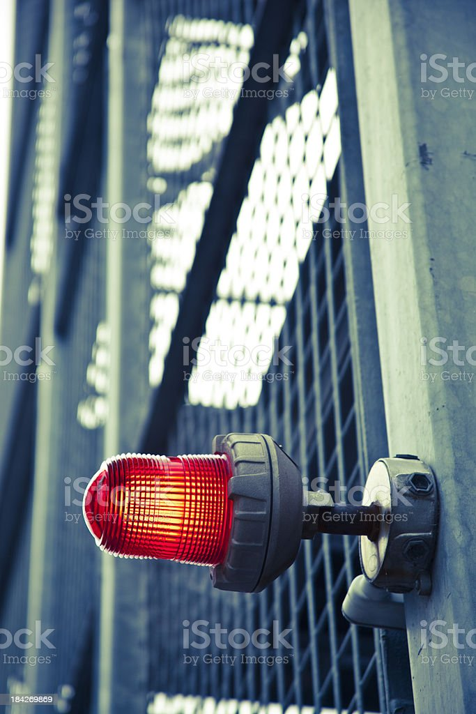 Close-up of a red emergency light on the wall stock photo