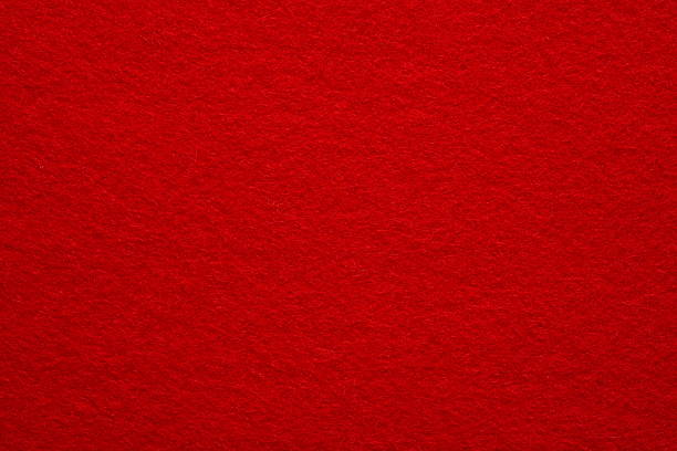 A close-up of a red felt background stock photo