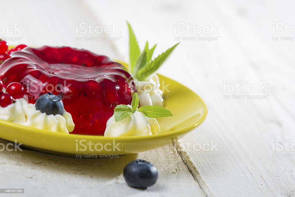 Closeup of a red jelly with fruits stock photo