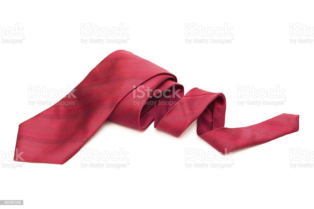 A close-up of a red necktie rolled on a white background royalty-free stock photo