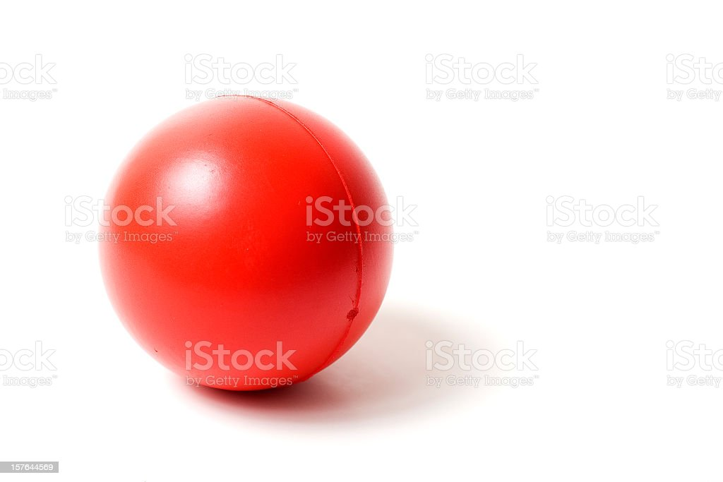 Close-up of a red rubber stress ball on white background stock photo
