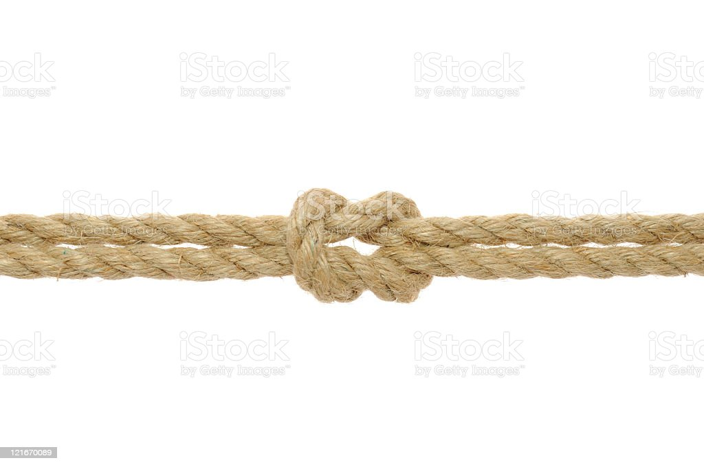 Close-up of a reef knot on a jute rope stock photo