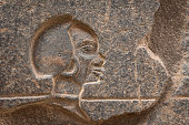 Closeup of a Relief showing a Nubian woman on the wall of an egyptian temple,