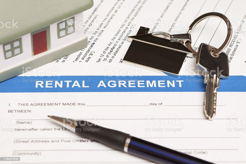 Close-up of a rental agreement with keys and a pen stock photo