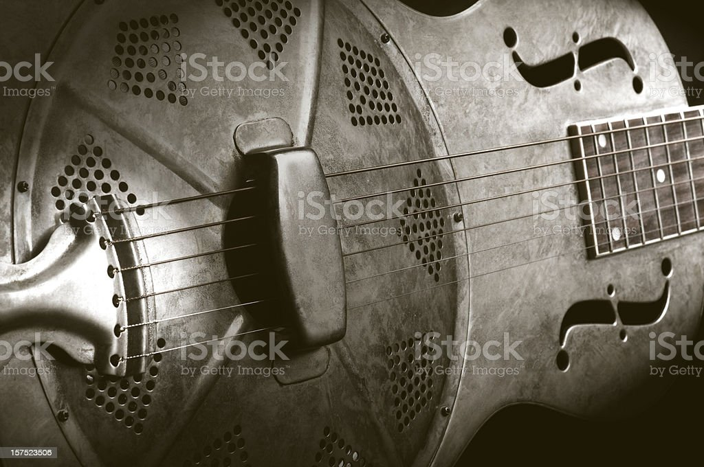 Close-up of a resonator guitar in sepia tones stock photo