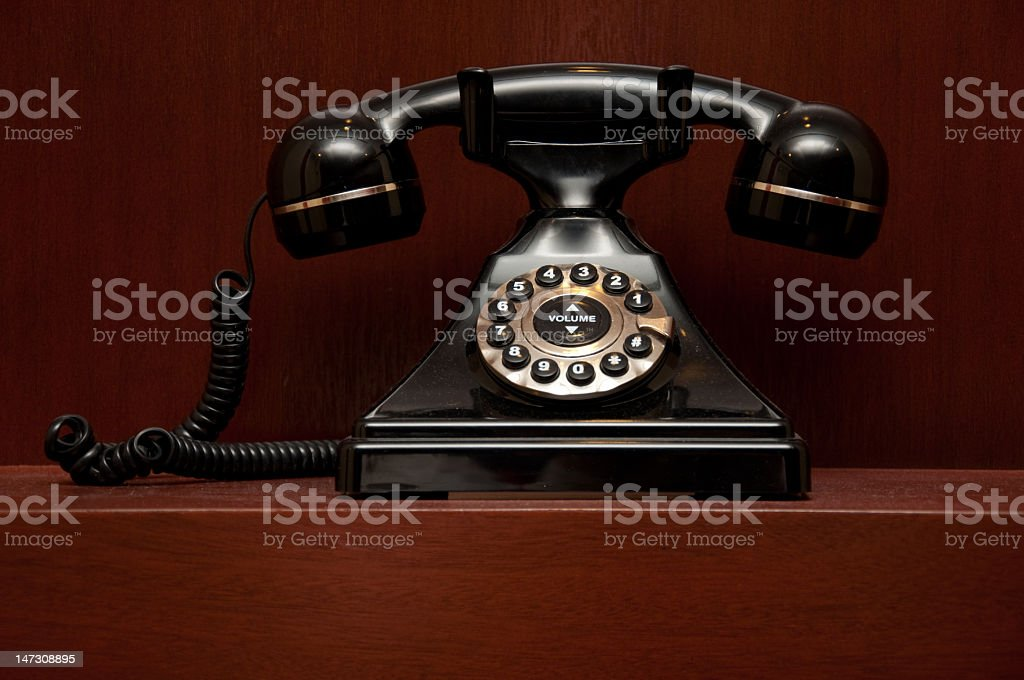 Close-up of a retro telephone on a wooden shelf stock photo