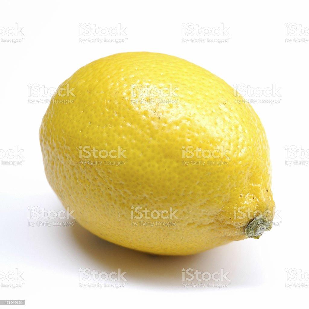 A closeup of a ripe and yellow lemon royalty-free stock photo