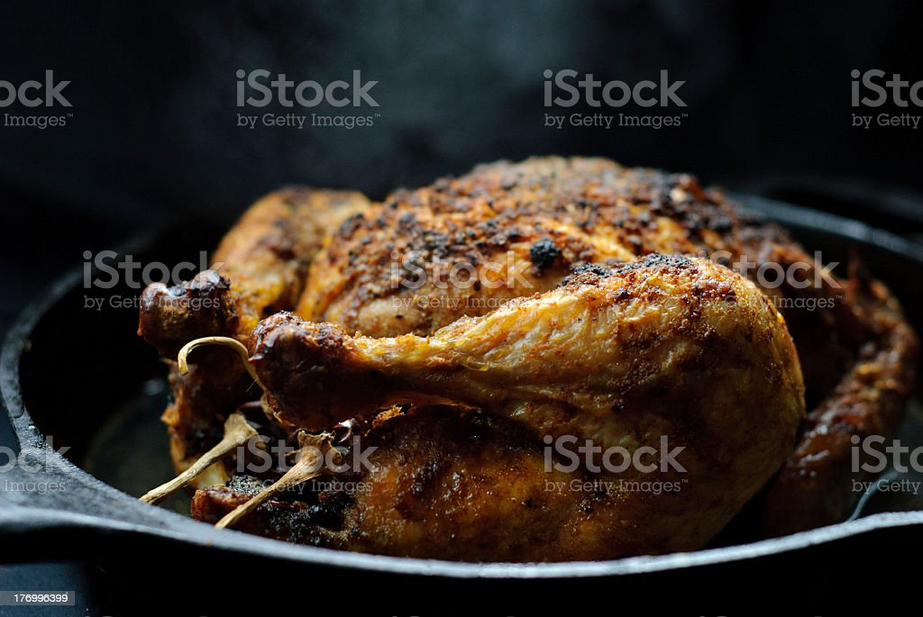 Close-up of a roasted chicken in pan stock photo
