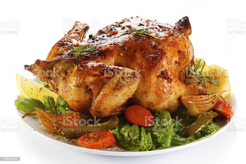 Close-up of a roasted chicken with vegetables stock photo