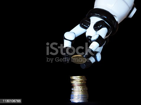 Close-up of a robotic hand stacking euro coins isolated on black background
