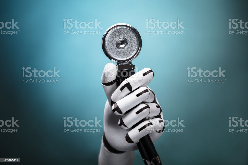 Close-up Of A Robot's Hand Holding Stethoscope stock photo