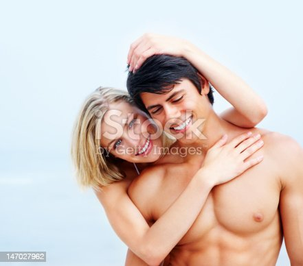 135359671 istock photo Close-up of a romantic young couple smiling on the beach 147027962