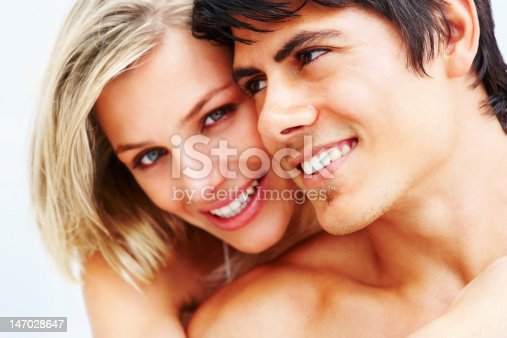 135359671 istock photo Close-up of a romantic young couple smiling 147028647