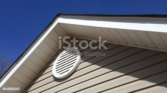 istock Closeup of a roof vent on a house. 644695340
