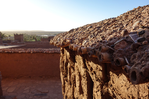 Close-up of a rooftop of a building in the clay kasbah of Ait Ben Haddou, a 'fortified city' or ksar, between the caravan route Sahara and Marrakesh, Morocco