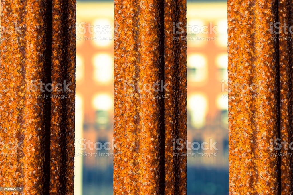 Close-up of a rusted steel fence stock photo
