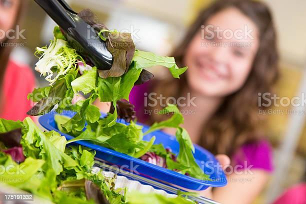 Closeup of a salad being served to school students picture id175191332?b=1&k=6&m=175191332&s=612x612&h=wucbtwo1eq nzmdct6tbexcju9eljq2jkqp6fik4cz8=