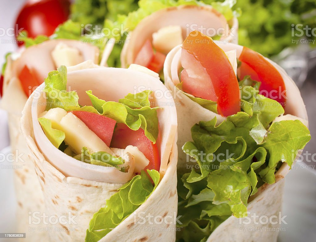 A closeup of a salad filled tortilla wrap stock photo