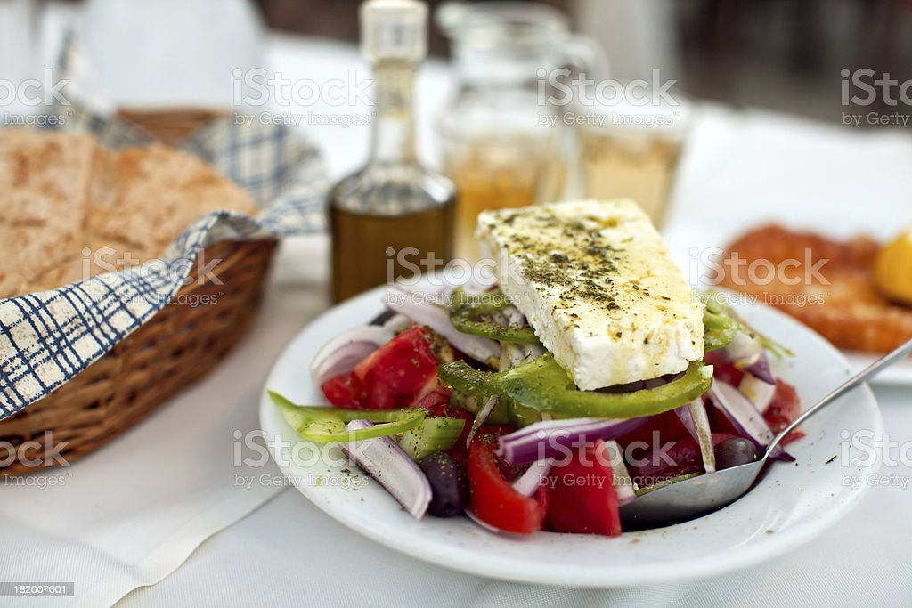 Close-up of a salad with a breadbasket on a table stock photo