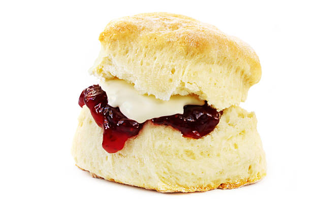 close-up of a scone with jelly and butter isolated on white - scone bildbanksfoton och bilder