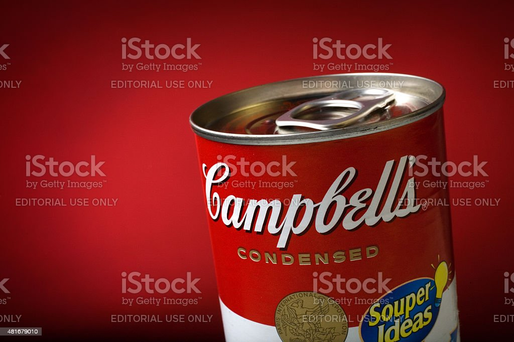 Close-Up of a Sealed Campbell's Soup Can on Red Background stock photo