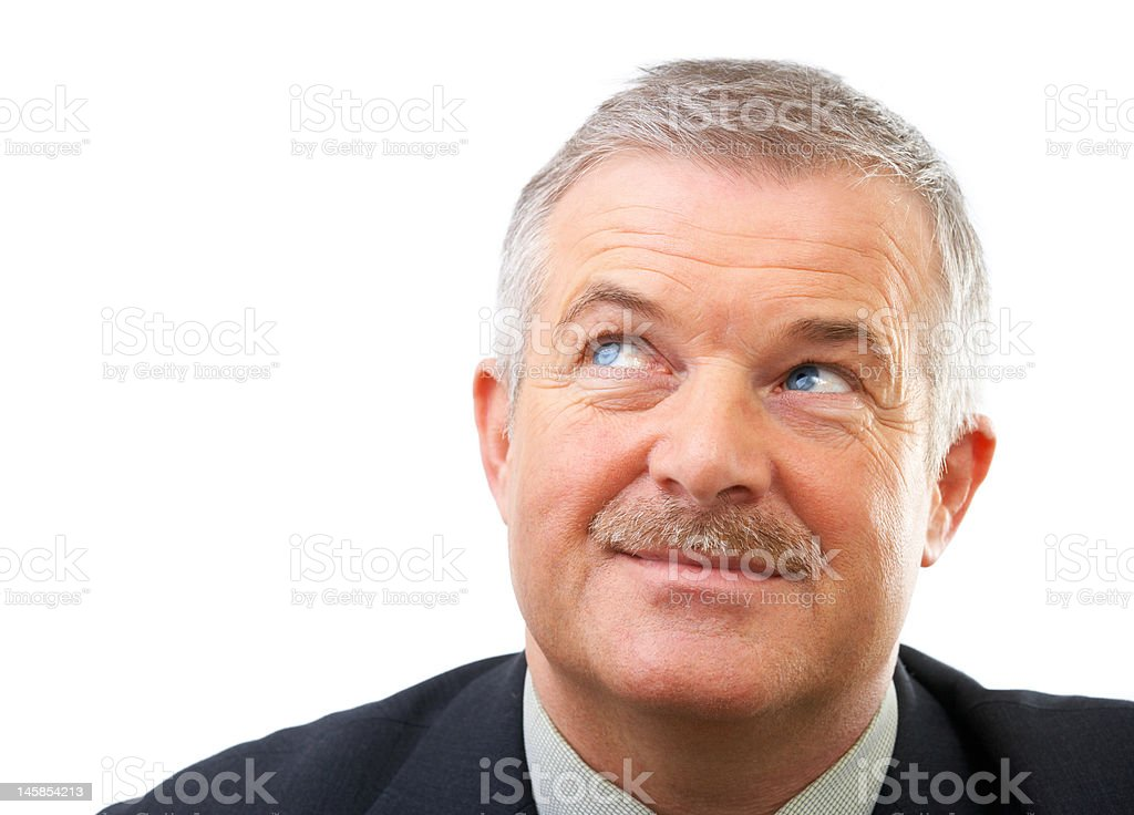 Close-up of a senior businessman looking up royalty-free stock photo