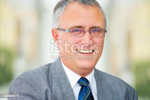 825083248istockphoto Close-up of a senior businessman smiling 144965815