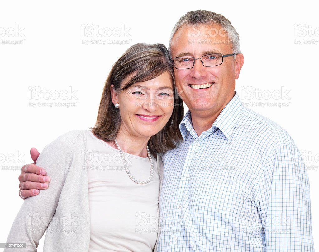 Close-up of a senior couple smiling on white background royalty-free stock photo