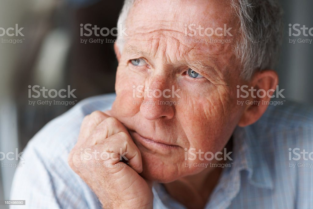 Close-up of a senior man contemplating royalty-free stock photo