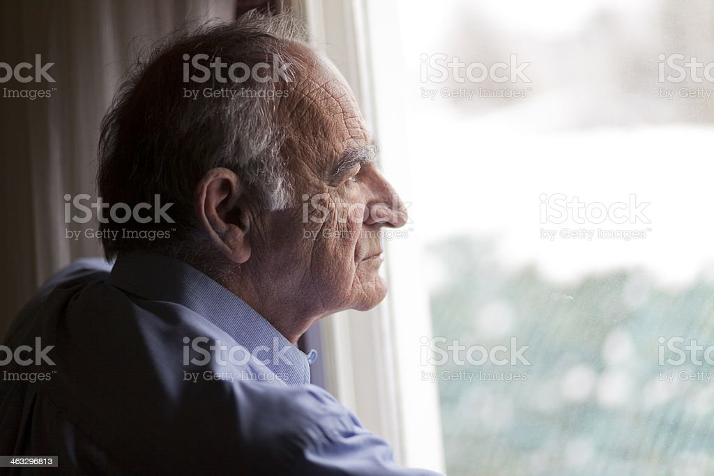 Close-up of a senior man contemplating stock photo