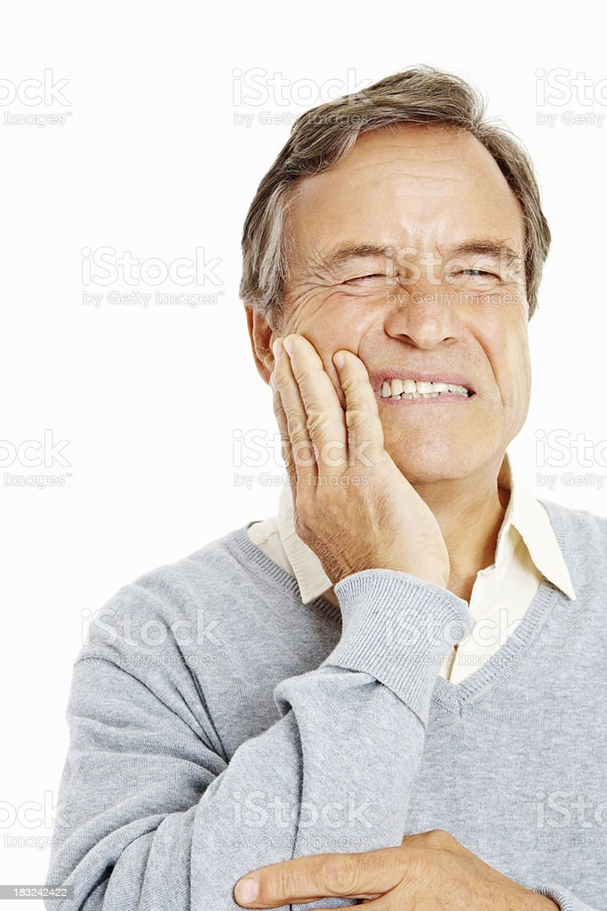 Closeup of a senior man holding teeth in pain stock photo
