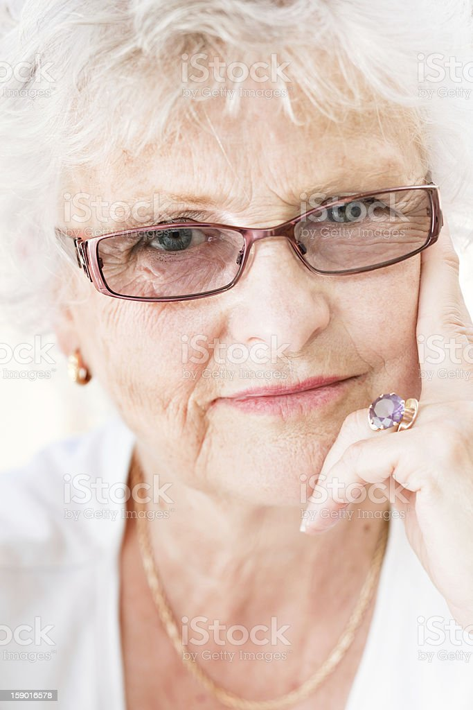 Close-up of a senior woman looking smart royalty-free stock photo