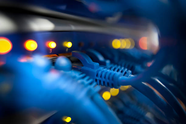 closeup of a server network panel with lights and cables - kablo stok fotoğraflar ve resimler
