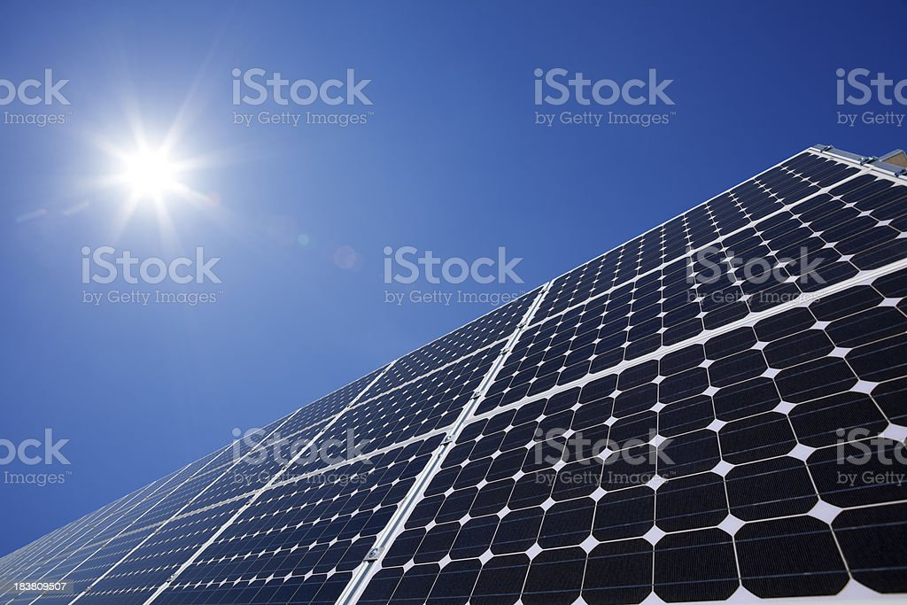 Close-up of a set of giant solar panels under a sunny sky stock photo