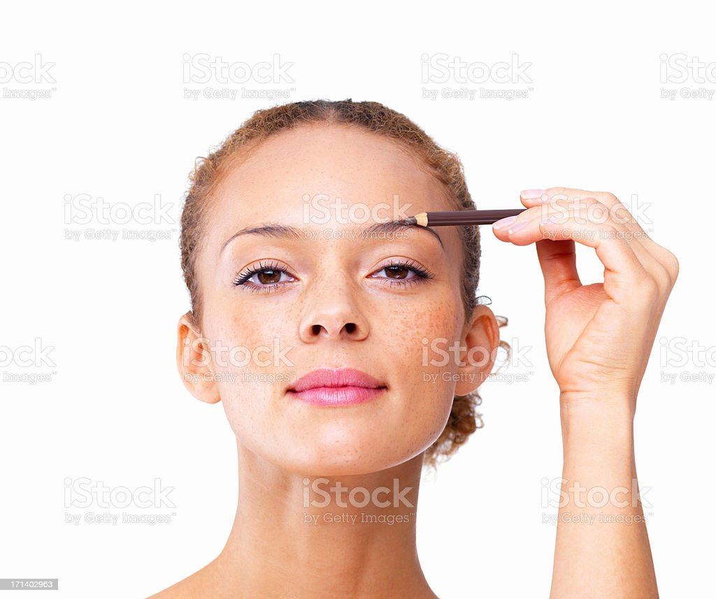 Closeup of a sexy girl applying eyebrow pencil isolated on white background stock photo