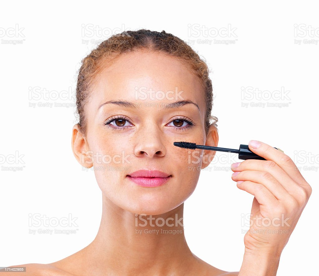 Closeup of a sexy girl applying mascara isolated on white background stock photo