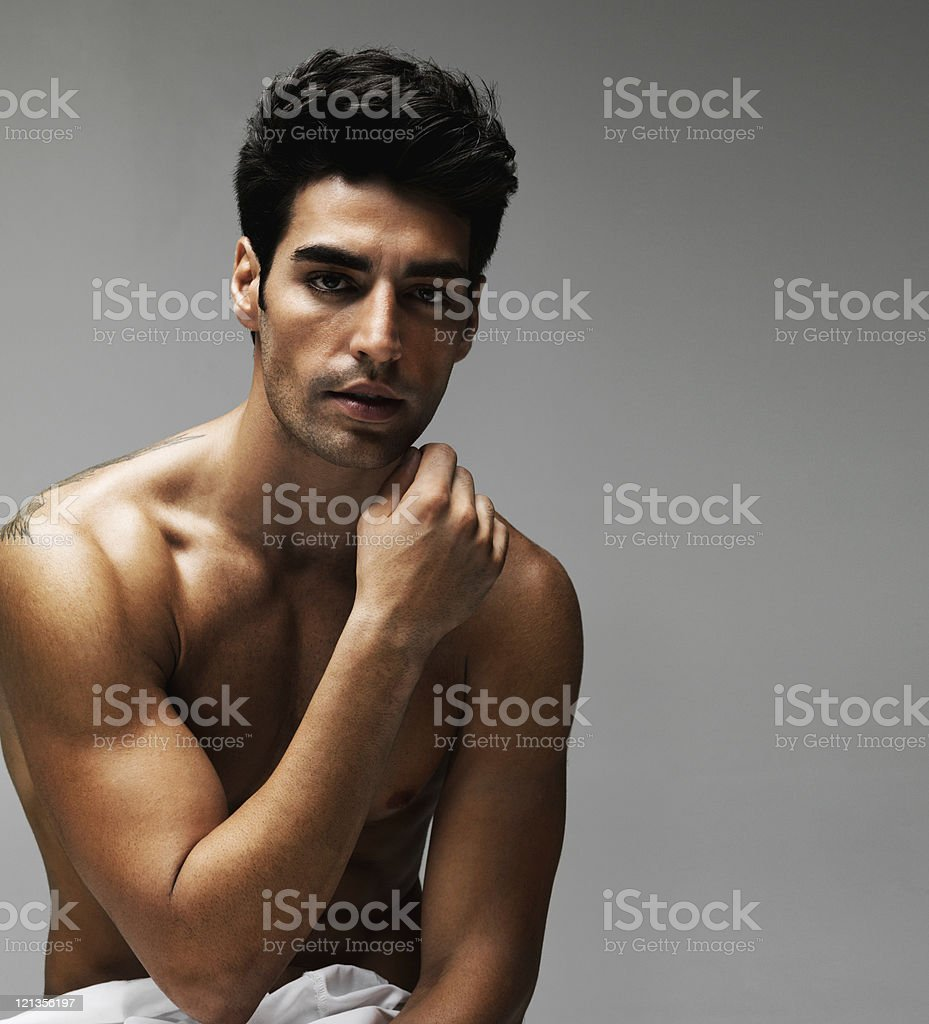 Closeup of a sexy shirtless fitness model isolated on gray royalty-free stock photo