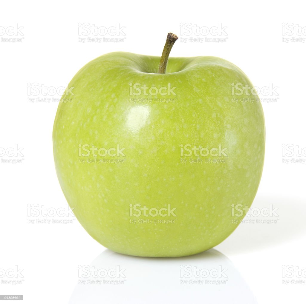 Close-up of a shiny green apple on a white background stock photo