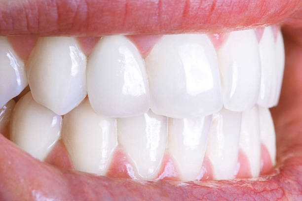 Close-up of a shiny white human teeth stock photo