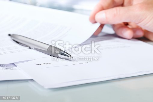 istock Close-up of a silver pen with documents. 491713762