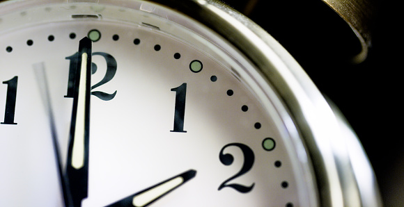 Close-Up of a Silver-Colored, Metal, Retro-Style, Analog Alarm Clock Almost Striking 2:00