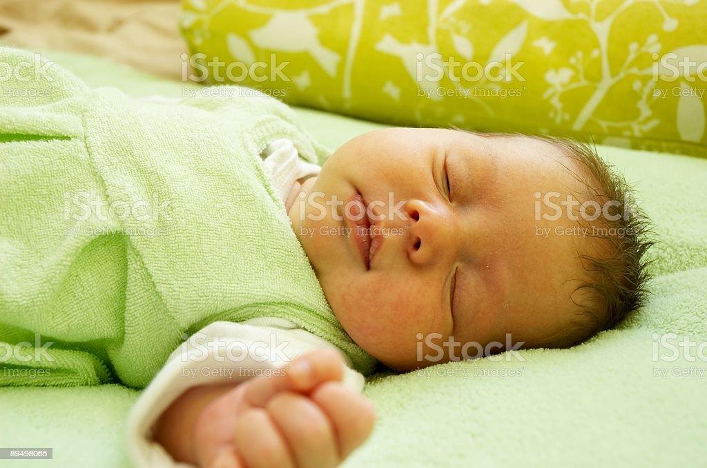 Close-up of a sleeping newborn baby with arms out royaltyfri bildbanksbilder