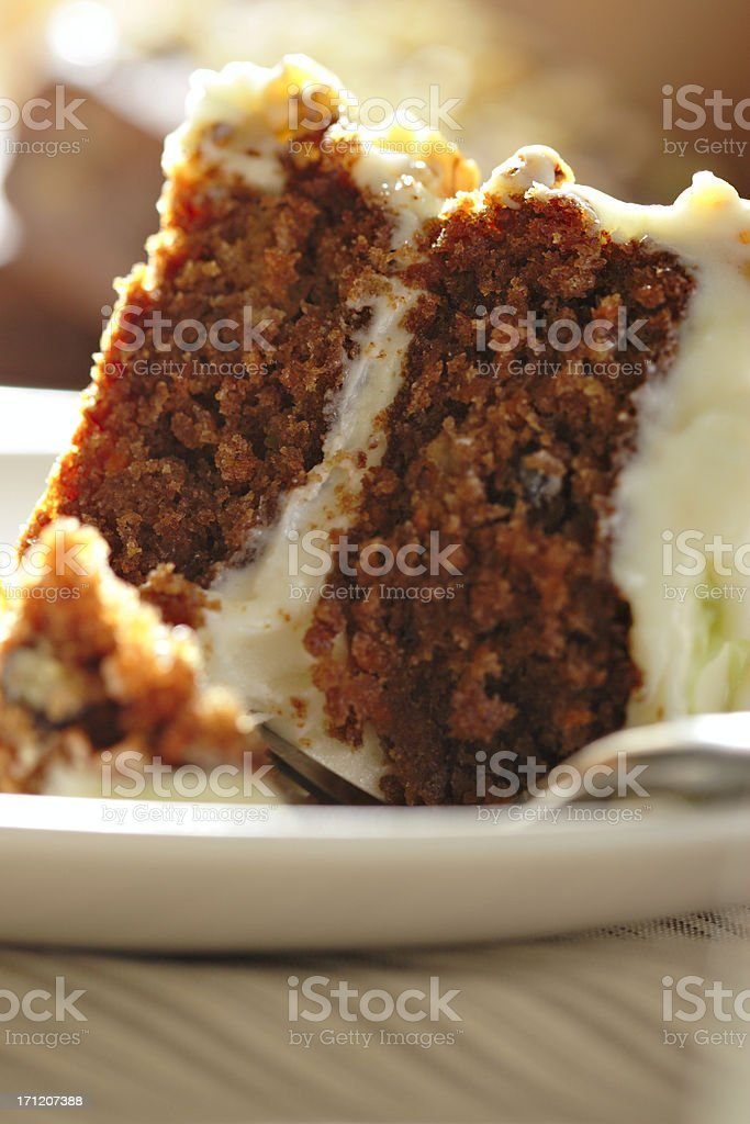 Close-up of a slice of carrot cake with cream royalty-free stock photo